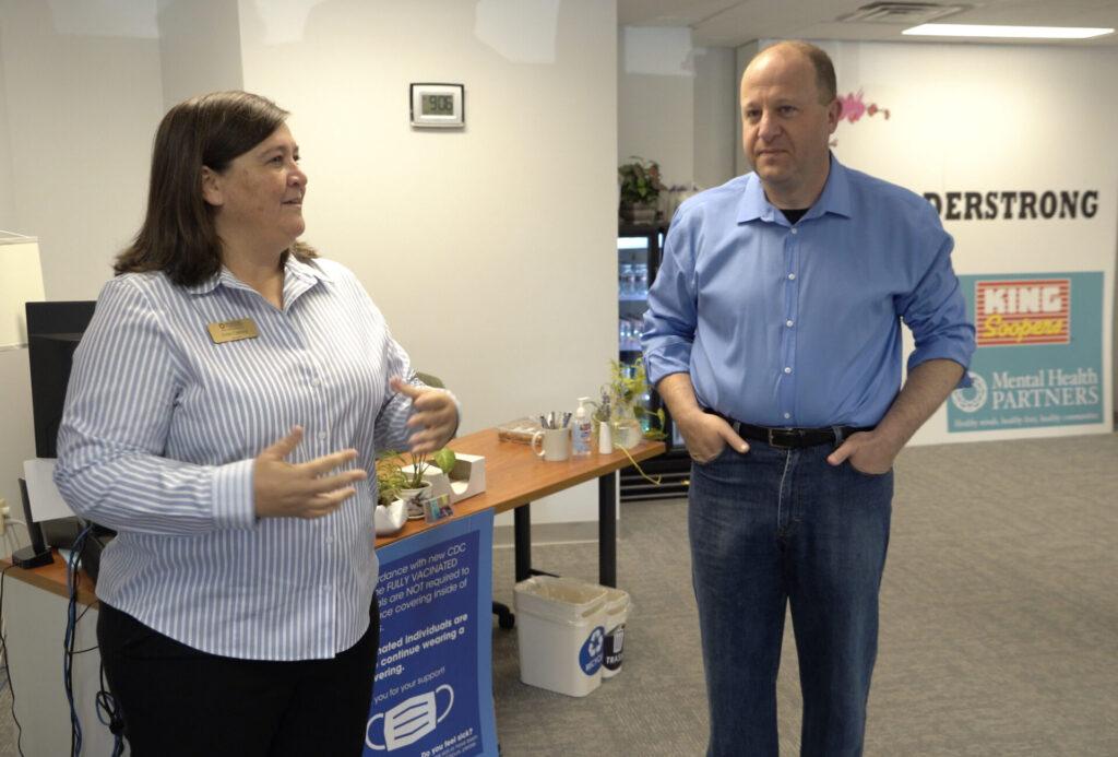 Dixie Casford, co-CEO, Mental Health Partners, welcomes Gov. Polis.