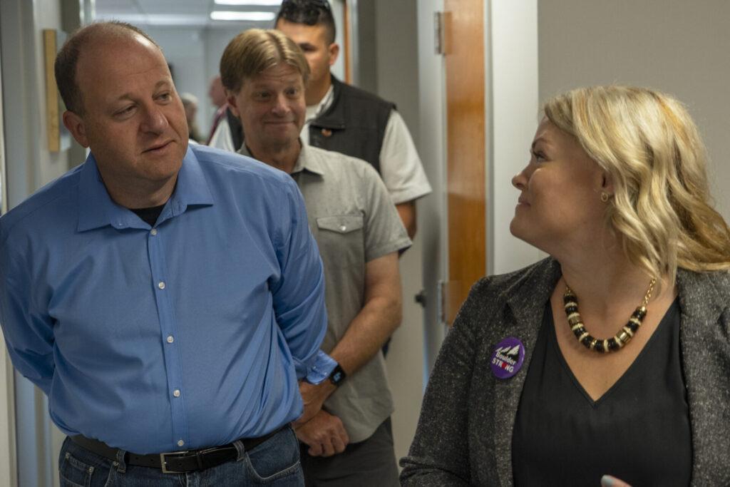 BSRC supervisor Karen Schweihs gives a tour to Gov. Polis and Mayor Sam Weaver.